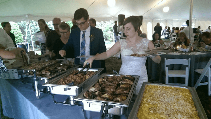 a bride and groom enjoying their bbq wedding catering in Central Jersey
